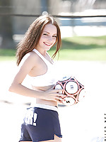 Hottie is outside in shorts and tee playing volleyball but with a soccer ball lol