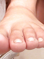 How hot is this see bailey lotion up her toes in between them and upclose