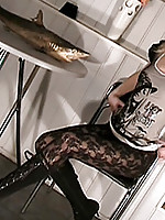 Elisa shows off her petite teen frame in black lace pantyhose