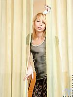 Elegant blonde teen cutie in pantyhose flirting on couch