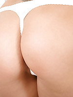Cindy, nubiles brown eyed beauty has a perfectly round ass just right for spanking.