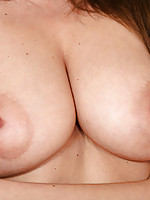 Big breasted nubile massages her delicate nipples and large areolas