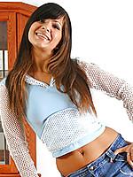 Long haired brunette teen flirtatiously flaunts her body