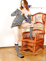 Virgina shows off her sexy teen frame in a striped outfit
