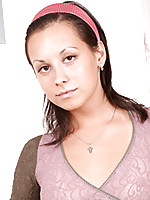 Elise has deep brown eyes that seduce with just a glance.