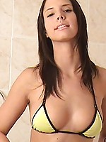 Bikini hottie monika is in the bathroom disrobing before getting in