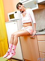 Szilvia looks amazing in her pink school girl skirt
