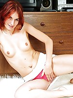 Fiery red headed nymph pulls her pussy lips apart revealing her hidden treasures