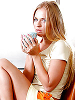 Stunning blonde teen charmer prepares for a day of masturbation with her morning cup of coffee