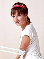 Leggy nubile teen bends over in her short white mini skirt
