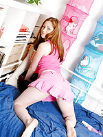 Lovely face teen in all pink sexy dress posing great on bed