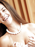 Nubile tere plays with herself on the bedspread