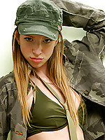 Playful all american teen peels off her army outfit and exposes her blushing pink pussy