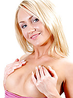 Captivating blonde nubile bends over and fingers her over heating pussy