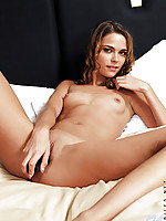 Naked nubile meggan simply covers her tight rosy pussy with her cute toy