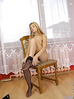 hot pantyhose babe sits doing what we want to see