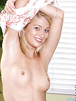 Naveah blonde and cute pulls off her shirt and has some fun relaxing