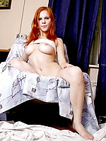 Long haired Nubile Jewel pops out her juicy tits and slowly pulls up her skirt