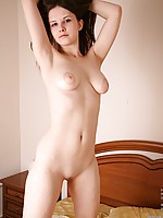 Tall shapely Nubile Makayla caresses her perfect body
