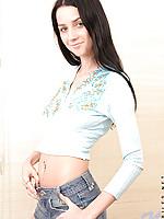 Sensual teen hottie enjoys posing on soft mattress looking naughty