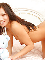 Internet asian cutie with teddy strip teasing in bed