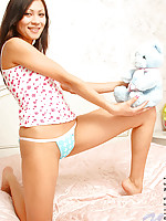 Tapenga playing sexily with her teddy in bed