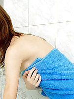 Petite red headed teen cleanses her pale skin with a detachable shower head