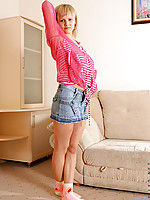 Hot voluptuous Teena sliding off her mini skirt on the couch