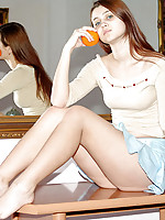 Juicy looking teen with orange seducing