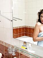 Maura admires her fresh teen looks in the bathroom mirror