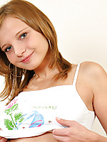 Laceys white tee and booty shorts emphasize her youthful innocence.