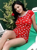 Teenage florencia lounges poolside in her hot red polkadots