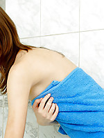Red headed Nubile Arianna adjusts the water for her erotic shower