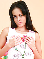 Nubile Riley massages her teen breasts through the fabric of her shirt