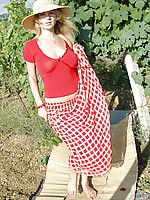 Milana ready to take off her plunging red blouse under the heat of the sun