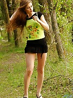 Adventurous cute teen posing and flashing colorful thong in the woods