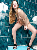 Nubile Kesia bends over and dips her fingers in her sweet snatch